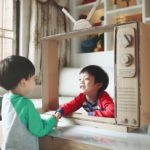 Children and a handmade toy TV